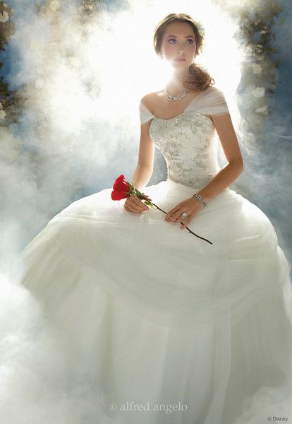Belle Wedding Gown<br /> <br /> Princess Belle's wedding dress, with a draped waistline is inspired by the iconic ballroom dance scene from the film and focuses on making a grand entrance.