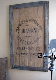 Framed antique French grain sack, love this idea and will have to do this!