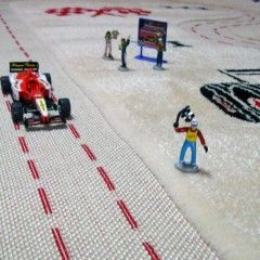 Play rug for fast cars, with sample cars and figures