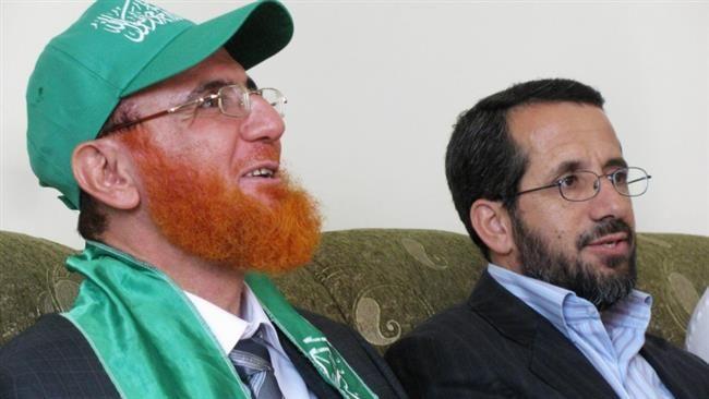 Palestinian Hamas-affiliated lawmaker Muhammad Hassan Abu Tir (L)