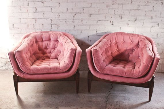 Cushy pink velvet chairs add vintage flair. These look so comfy and nice and low to the ground - perfect for my short legs