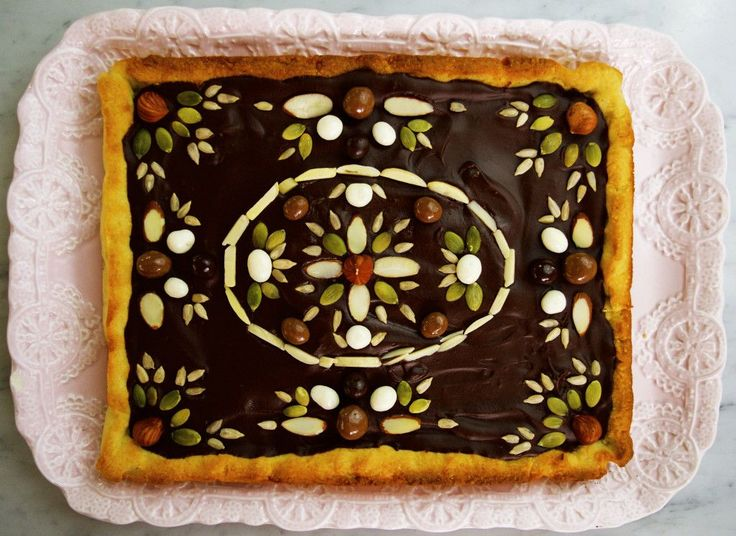 A polish dessert with a very rustic feel to it. This Mazurek is made with almond shortbread, topped with chocolate and decorated with seeds and sweets.
