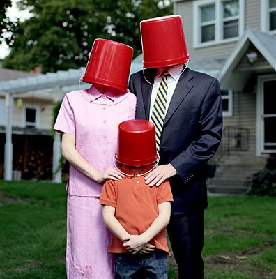 Oh yes, the bucket head family... living next to the family who plays Toss the Baby in the front lawn.