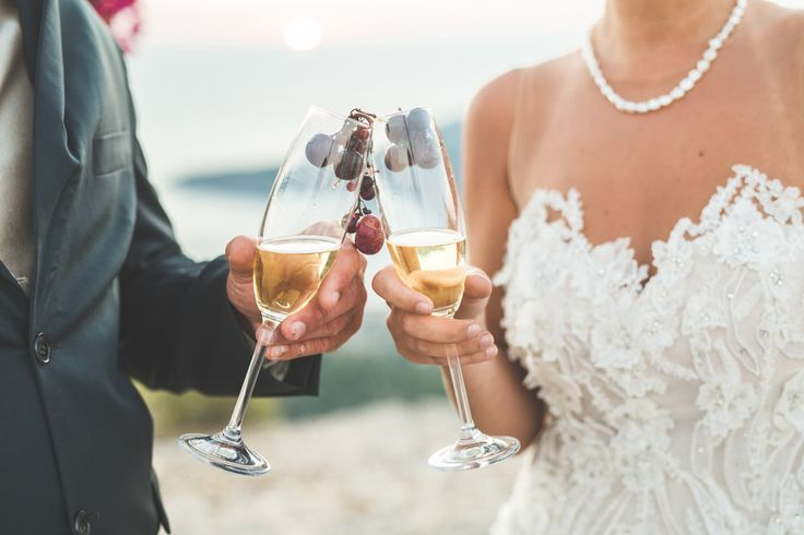 Couple holding a glass of wine