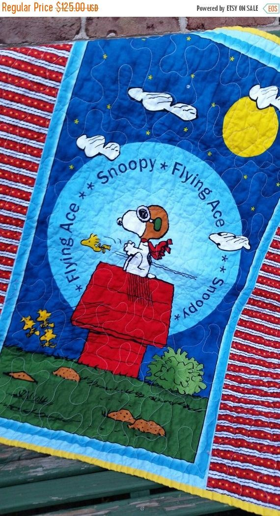 Snoopy Crib Quilt Blanket, Snoopy Nursery Bedding, Woodstock, Peanuts, Flying Ace Wallhanging, Charlie Brown, Lucy, Toddler, Gender Neutral by QuiltsForU2 on Etsy https://www.etsy.com/listing/249311609/snoopy-crib-quilt-blanket-snoopy-nursery
