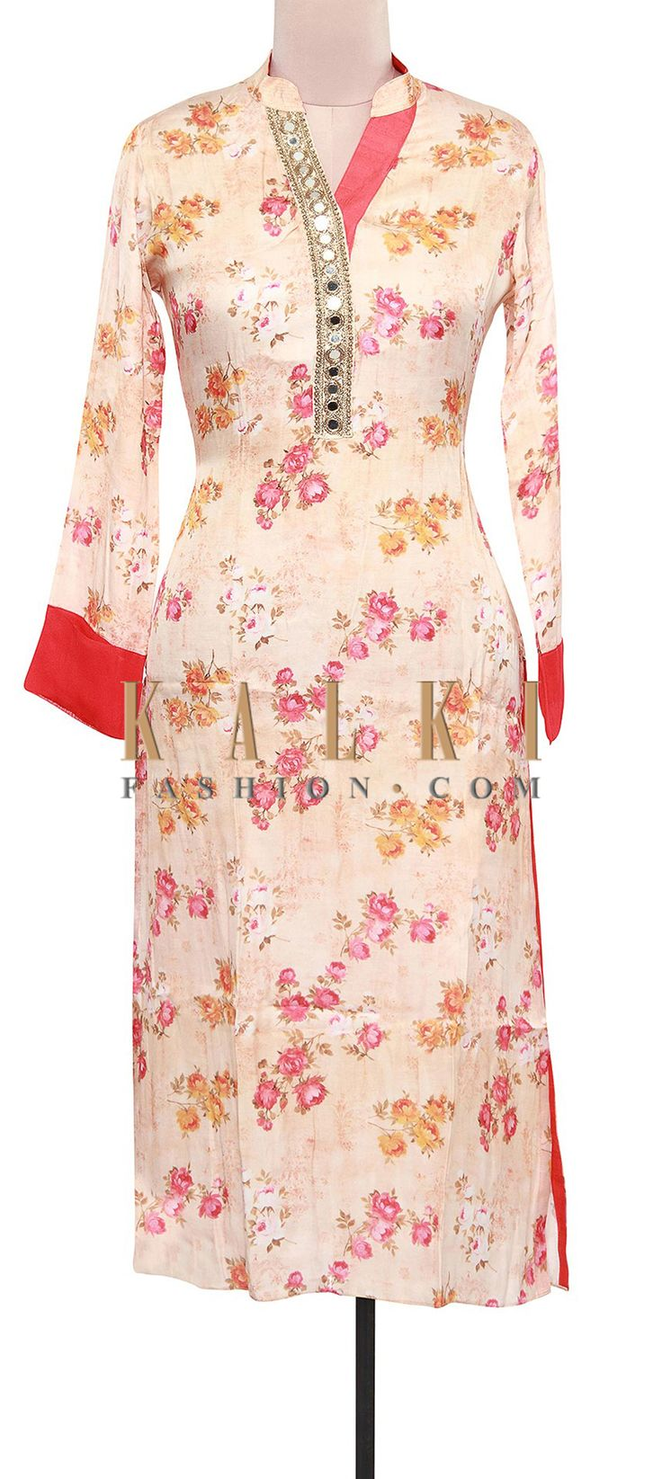 Buy Online from the link below. We ship worldwide (Free Shipping over US$100). Product SKU - 309150.Product Link - http://www.kalkifashion.com/cream-floral-printed-kurti-adorn-in-mirror-embellished-placket-only-on-kalki.html