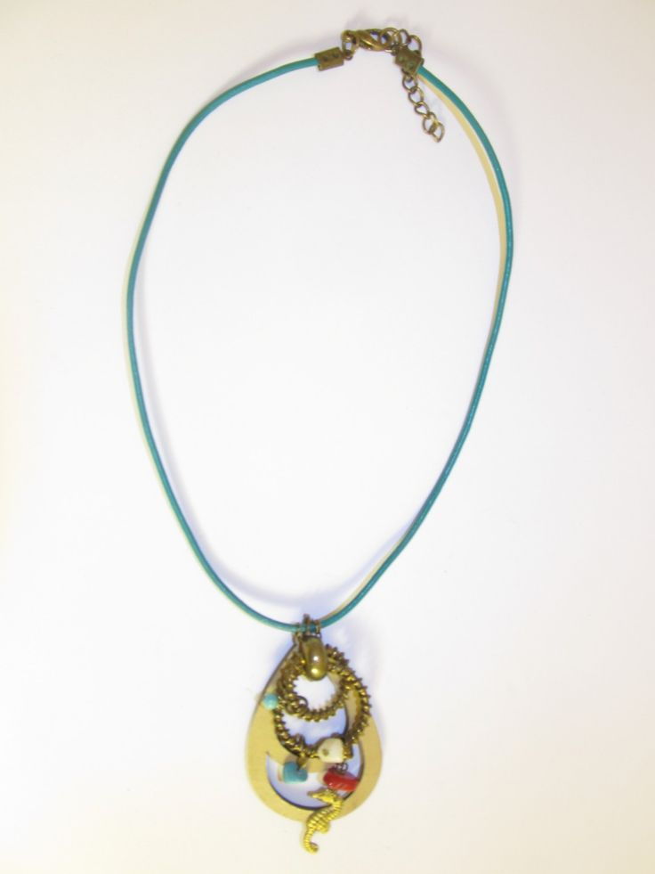 Handmade short leather necklace (1 pc)  Made with beige leather filigree, vintage brass metal, leather cord and semiprecious stones.