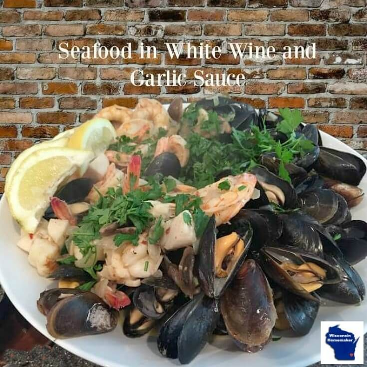 Pasta Fruitti di Mare or Seafood Medley in White Wine and Garlic Sauce is based on a classic Mediterranean recipe that cooks in under 15 minutes--pasta included. via @wihomemaker