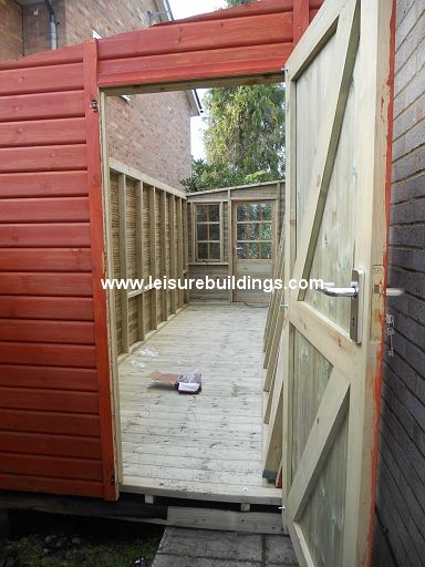 Lean to side passage storage shed