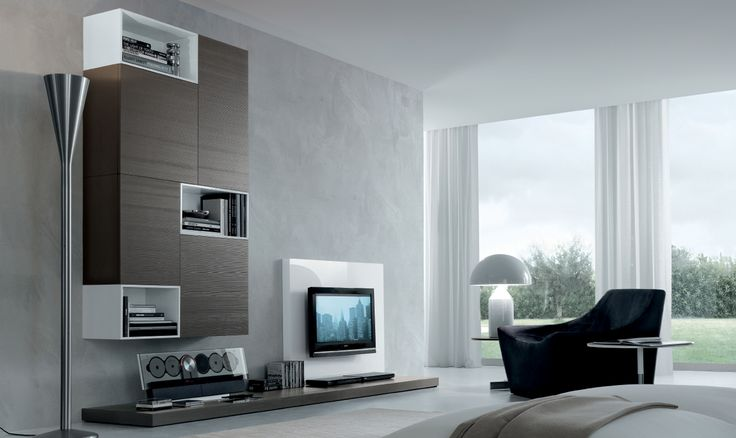 Wall unit system in a flexible modular style with a high range of options for storage and audio visual use. This modern Italian piece is the latest in furniture design trends...