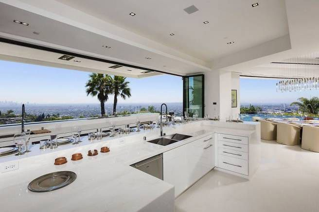 Beyonce and Jay-Z were reportedly checking out an $85 million Beverly Hills mansion with a sleek, all-white kitchen. The views of the Los Angeles skyline should be reason enough to buy the home.