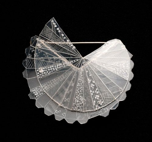 Kristin D'Agostino  Brooch: Rogan Josh 2012  Fishing line, take away container, silver   7 x 7 x 2 cm