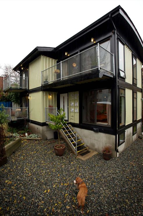 Recycled Shipping Container House with Chain link patio railings.