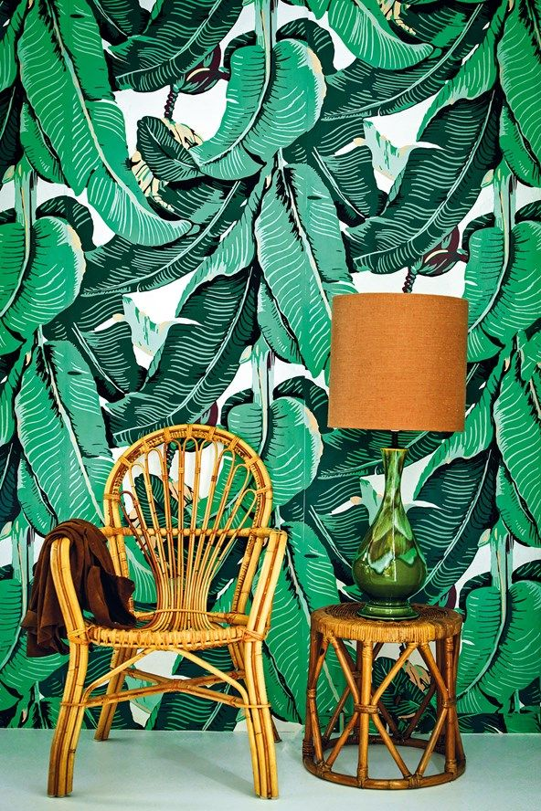 Palm print wallpaper in large scale with bamboo furniture in the glorious Can Mimosa villa to rent in Ibiza. Read the full details here: http://www.cntraveller.com/recommended/beaches/ibiza-best-hotels-restaurants-villas-beachclubs