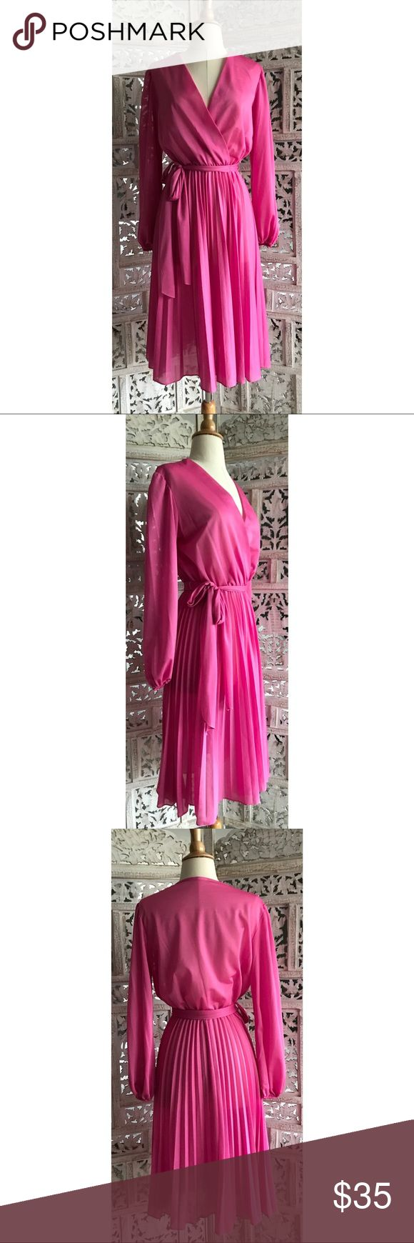 """Vintage 70's pleated dress Vintage 1970's semi-sheer American-Hustle-worthy dress in bold magenta. Faux wrap front with balloon sleeves, a flowy pleated skirt and self tie belt. There are a few marks on the front bust line, probably where it was pinned together for modesty. With some steaming they're not very noticeable. Wear over a pink or nude slip, heels and call it a night. Lying flat 17"""" bust, 11-16"""" expandable waist, 42"""" long, 17"""" inner sleeve. Vintage Dresses"""