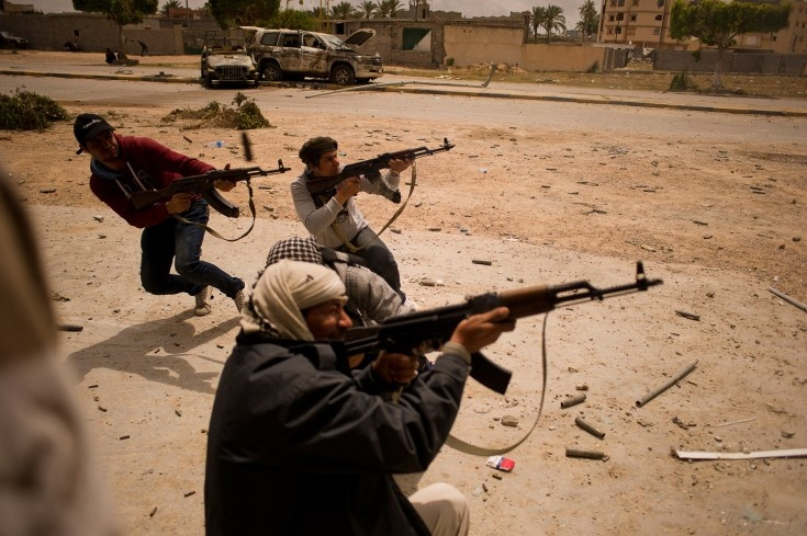 April 20, 2011. Rebel fighters in a dispute with pro-government soldiers in Tripoli Street, Misrata, Libya. André Liohn—Prospekt
