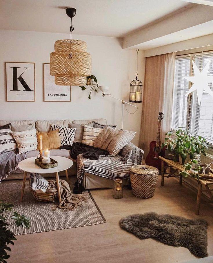 Bohemian living room with basket lighting, framed prints, indoor plants, modern …