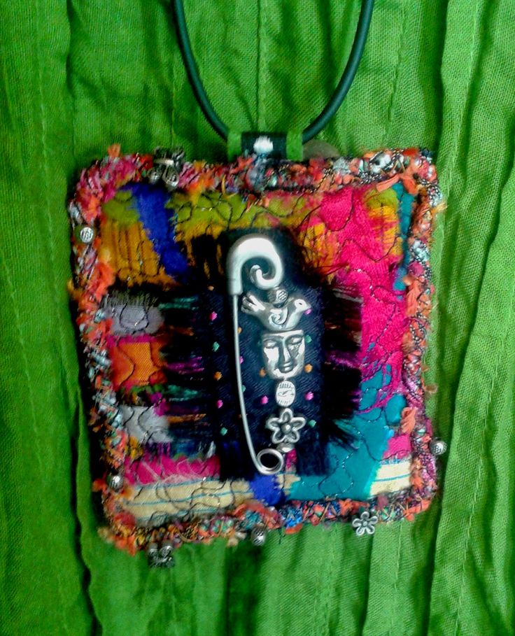 *Textile pendant I've just made using felt scraps, recycled sari silk offcuts, silver beads and charms, and fibers.  Looks great with a white linen tunic. Big and chunky.
