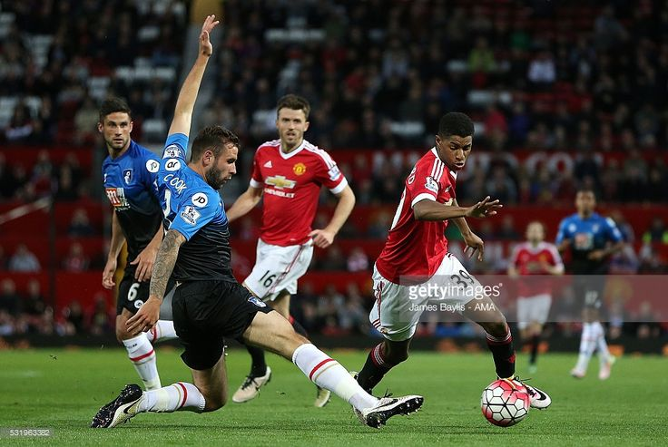 Marcus Rashford of Manchester United competes with Steve Cook of Bournemouth during the Barclays Premier League match between Manchester United and AFC Bournemouth at Old Trafford on May 17, 2016 in Manchester, England.