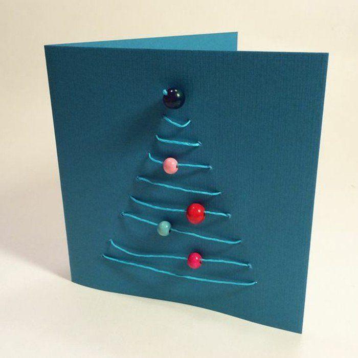 carte de noel a faire soi meme, un arbre de noel, constitué de fils bleis et de perles en guise de boules de noel
