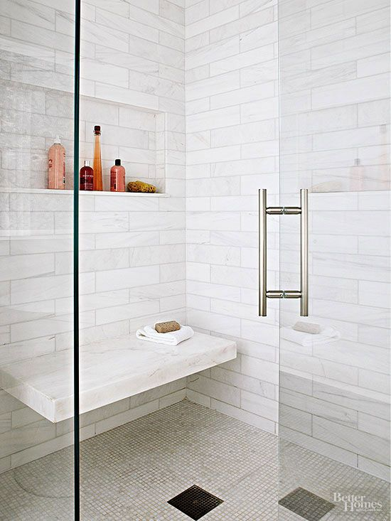Instead of installing a weighty shower bench in your walk-in shower, opt for a sleek floating seat that doesn't clutter up the interior. Appearing to seamlessly jut out from the rear shower wall, this thick marble ledge tiptoes into view beneath a toiletry niche that mirrors the shower seat's horizontal silhouette./