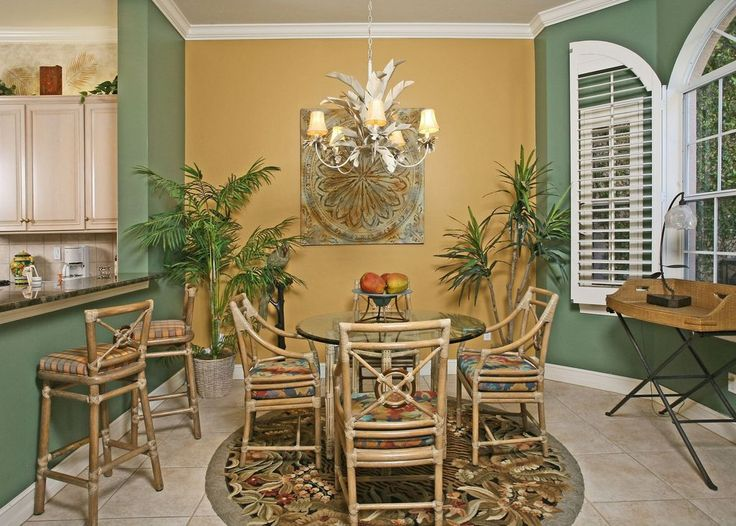 Tropical Dining Room with New Pacific Cream Dining Table, High ceiling,  Crown molding,