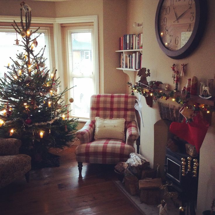 English country Edwardian sitting room at Christmas. Walls painted in Farrow and Ball 'Savage Ground'. Chair: Gibson by John Sankey, available at John Lewis, in Sanderson 'Rupert Check'. Cosy!