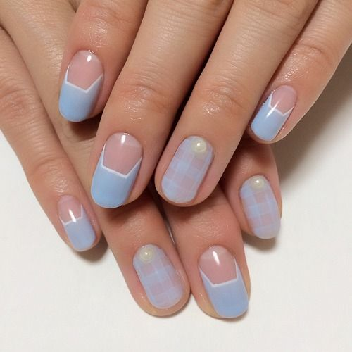 Pale blue nail art.