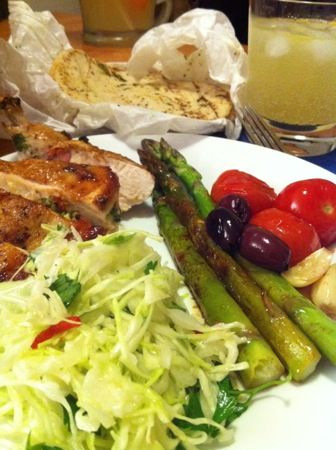 Jamie Oliver's 30 Minute Meal: Stuffed Cypriot Chicken, Pan-Fried Asparagus and Vine Tomatoes, Cabbage Salad, and St. Clement's Drink.