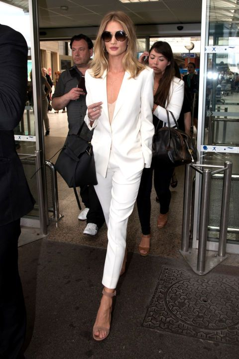 13 celebrity summer suits: Rosie Huntington-Whiteley's stuns in a white pants suit a nude pumps