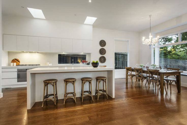Spacious, Modern Kitchen and Dining Areas Contemporary Weatherboard Home on a sloping block.
