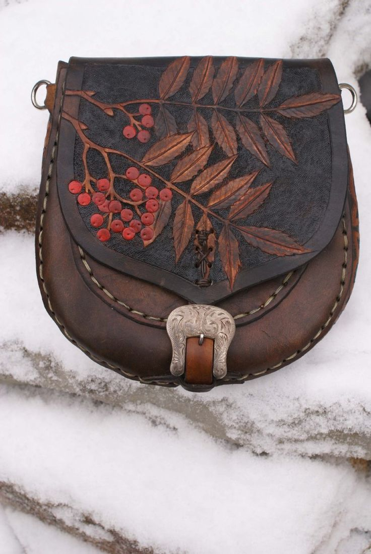 warm brown sporran with hand carved rowan leaves and Celtic knotwork gusset