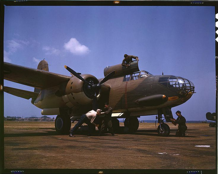 Servicing an A-20 bomber. Langley Field, Virginia, July 1942. Reproduction from color slide. Photo by Alfred T. Palmer. Prints and Photographs Division, Library of CongressLibraries Of Congress, A20 Bomber,  Military Planes, Colors, Aircraft, A 20 Bomber, July 1942, Virginia, Langley Fields
