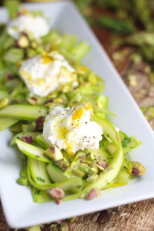Shaved asparagus spears are topped with a light lemon vinaigrette, toasted pistachios and dollops of ricotta.