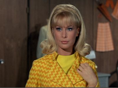 I Dream of Jeannie Barbara Eden looking chic with her yellow chevron blazer. I wonder what is happening with the rest of this outfit. 1960s fashion