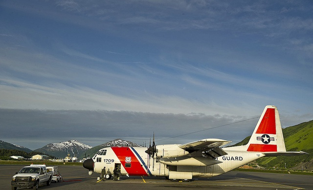 U.S. Coast Guardsmen conduct preflight checks on a Coast Guard HC-130H Hercules by U.S. Coast Guard, via Flickr