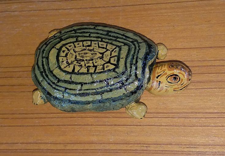 Turtle painting on road side stone   Turtle painting