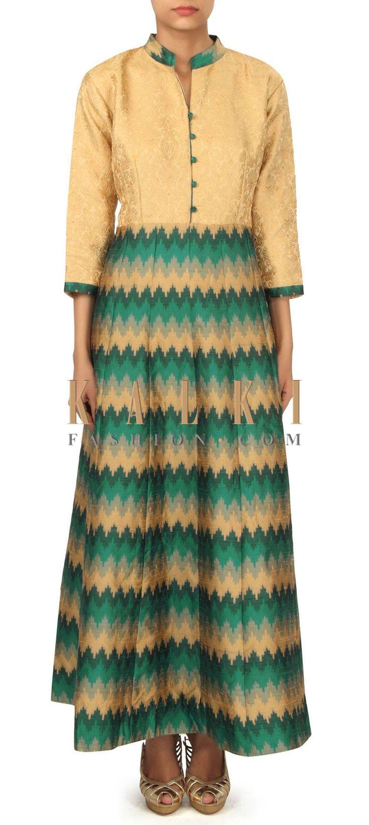 Cream and teal dress enhanced in ikkat motif only on Kalki