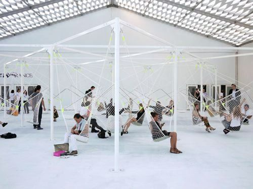 """mfdp: """" Industrial designer Konstantin Grcic installed seats made of netting suspended from a metal structure at Design Miami/ last week. """""""