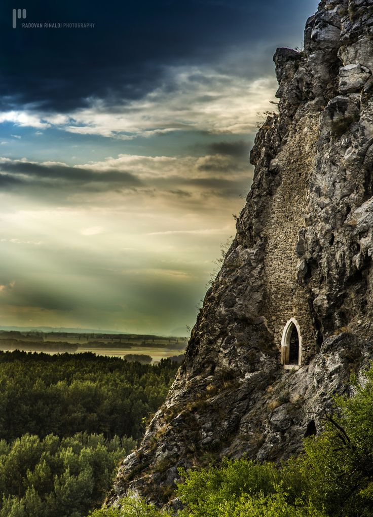 An ancient portal in Bratislava, Slovakia called the Chamber Of Secrets looks…