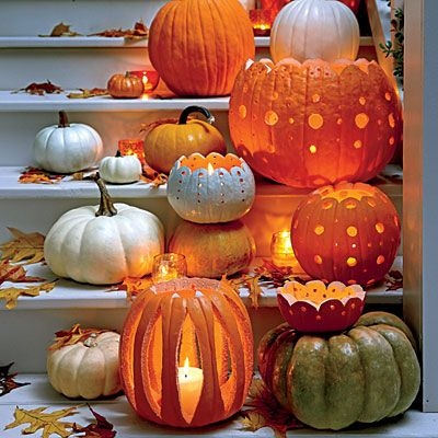 Carve a Pattern | Turn standard grocery store pumpkins into decorative votive holders that are embellished with polka-dot cutouts.