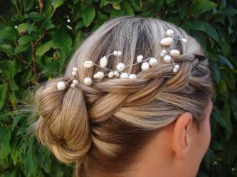 Google Image Result for http://wedding-pictures-03.onewed.com/35527/bohemian-chic-bridal-hairstyle-updo__teaser.jpeg