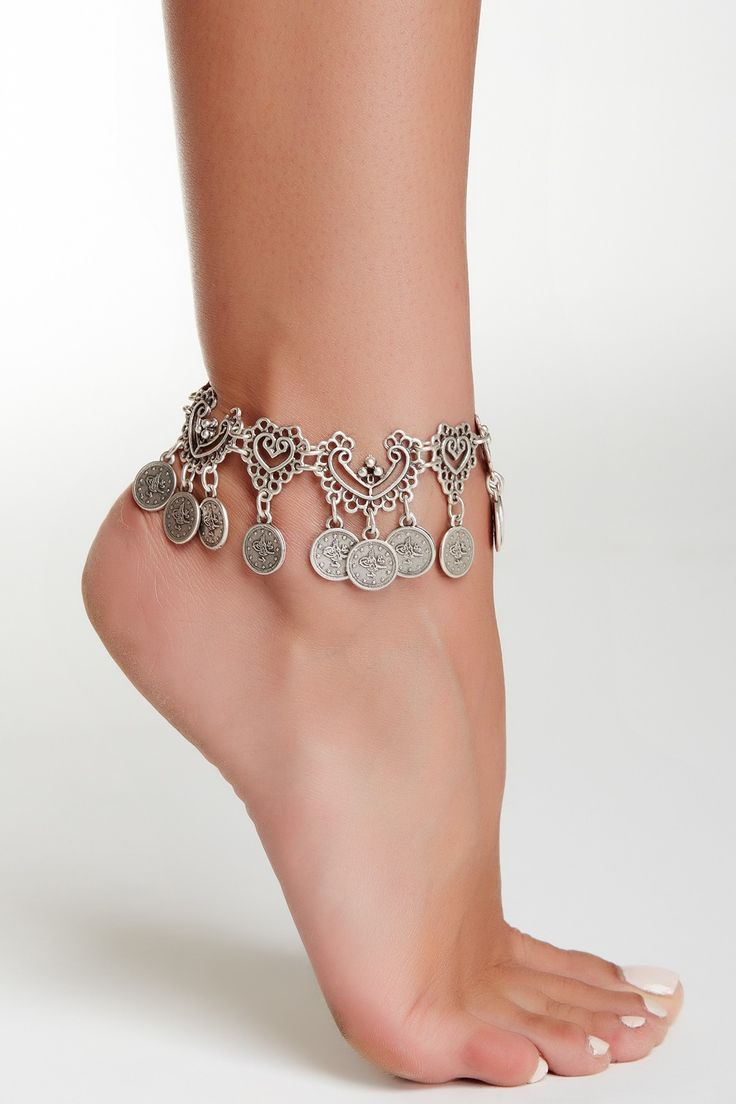 """Details: - Silver plated filigree link bracelet with coin charms - Lobster clasp - Approx. 8.25"""" length with 1.5"""" extension - Approx. 1.5"""" charm drop length - Imported Materials: Silver plated base me"""