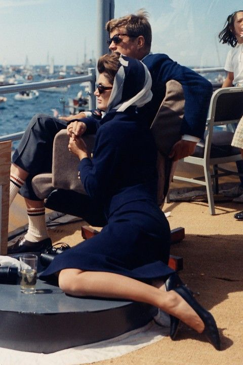 Jacqueline Kennedy Onassis watching the Americas Cup Race with John F. Kennedy from the Deck of the USS Joseph P. Kennedy, Jr. in Newport, Rhode Island. (1962)