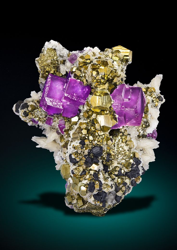 Fluorite on Pyrite with Calcite and Sphalerite - Milpo mine, Atacocha mining district, Pasco province, Peru  (Source: saphiraminerals.com)