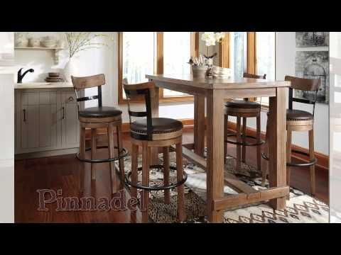 Pinnadel Dining Room Bar Table 4 Tall UPH Swivel Stools By Signature Design Ashley Get Your
