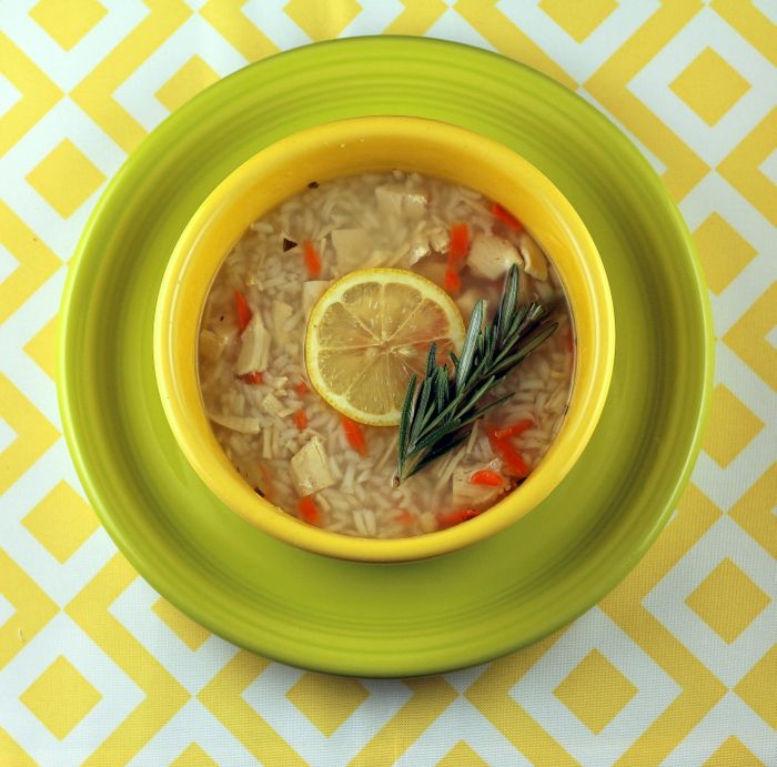Homemade chicken and rice soup zingy with fresh lemon and herbs and comforting rice.