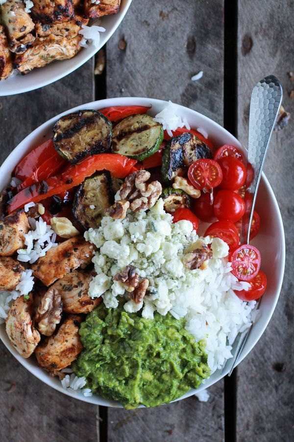 Chicken breasts, olive oil, garlic, onion powder, pepper, cayenne pepper, smoked paprika, parsley, basil, jasmine or basmati rice, red pepper, zucchini, avocados, lemon, grape tomatoes, walnuts, & crumbled blue cheese