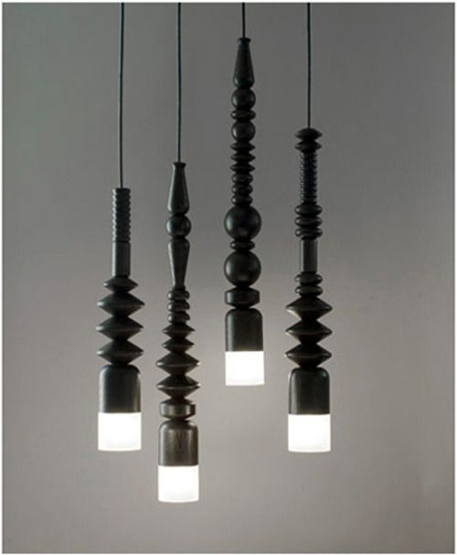 #lighting, love this, feels like left over chair or stair rail spindles . . .