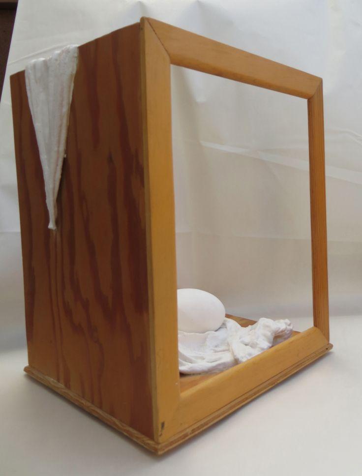 Open Sided Egg Box.  Plaster drapery and egg in pine box sculpture by L. Krahn Muenster